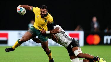 Kerevi is tackled by Dominiko Waqaniburotu during Australia's win over Fiji.