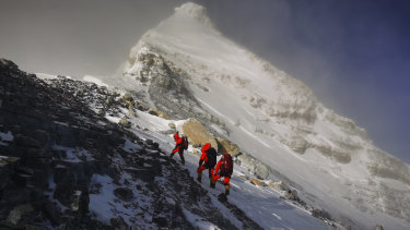 Members of a Chinese surveying team head for the summit of Mount Everest in May.