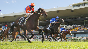 Glen Boss goes for home on Think It Over in the George Ryder Stakes.