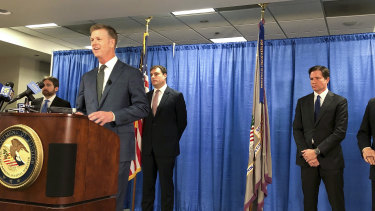 US attorney David Anderson announces criminal spy charges against San Francisco Bay Area tour operator Xuehua Edward Peng in San Francisco.