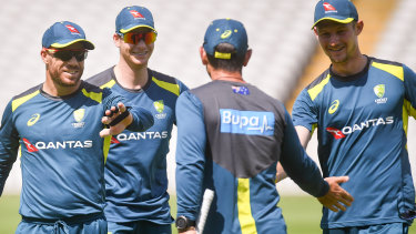 David Warner, Steve Smith and Cameron Bancroft greeted by Justin Langer at training on Monday.