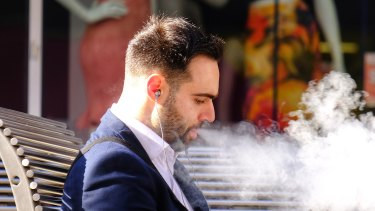 A man vaping on Bourke Street in October 2019.