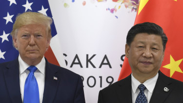 US President Donald Trump, left, poses for a photo with Chinese President Xi Jinping during a meeting on the sidelines of the G-20 summit in Osaka, Japan.