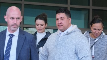 Hayden Tarawa (centre) at the Melbourne Magistrates Court with girlfriend Birdie Nauer (right).