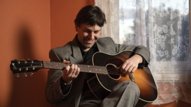 Alex Gow, musician and creator of One Guitar with the guitar at the centre of the podcast.