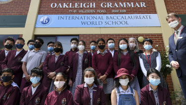 Oakleigh Grammar principal Mark Robertson with some of the school's international students who have stayed in Australia.