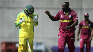 Short and sharp: West Indies' Andre Russell (right) checks on Australia's Usman Khawaja (left) after hitting him on the head with a bouncer during a World Cup warm-up match.