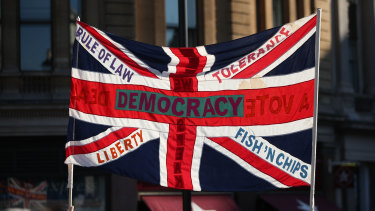 "Still disquiet about the looming break from the EU: A British Union flag is held aloft bearing slogans including ""Democracy"", ""Rule of Law"", ""Liberty"", ""Tolerance"" and ""Fish 'n' Chips"", during the People's Vote March, in London at the weekend."