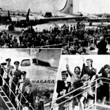 Crowds gather to watch the first passengers on the Australia-Canada service.