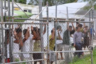 People seeking asylum in a detention centre on Manus Island in 2014.