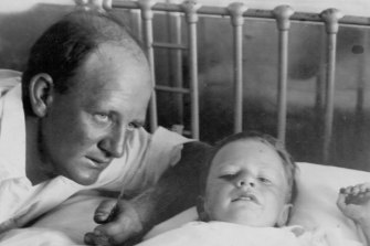 Steven Walls in hospital with his father after he was found.
