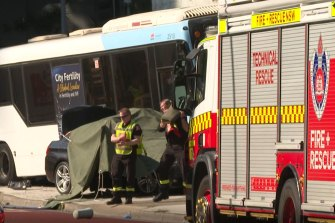 A woman in her 40s has died after a bus and a car collided in Sydney's west.