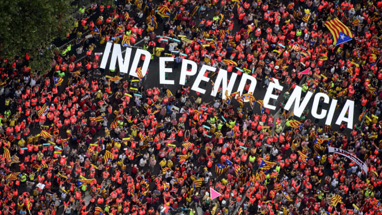 Independence supporters form the word Independence during Catalonia's National Day in Barcelona, Spain, on Tuesday.