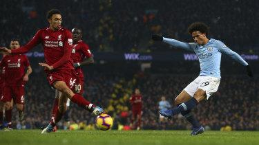 City's Leroy Sane scores the match-winner against Liverpool.