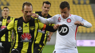 Oriol Riera challenges Wellington's Andrew Durante for the ball in last weekend's 3-0 win at Westpac Stadium.
