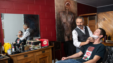The TRACE art program puts work from some of Australia's top artists into West End businesses, including a barbershop.