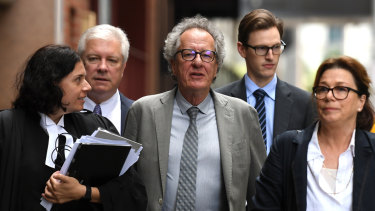 Geoffrey Rush, flanked by his barrister Sue Chrysanthou and wife Jane Menelaus, arrives at the Federal Court on Friday.
