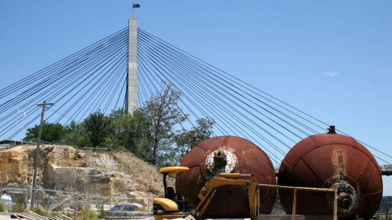 Two giant steel balls salvaged from the CSR sugar refinery were later installed in a harbourside park in Pyrmont.