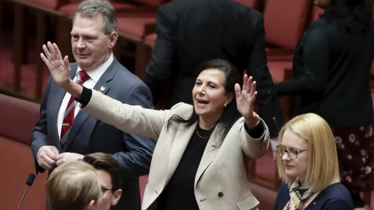 Senator Concetta Fierravanti-Wells takes her seat on the backbench during debate in the Senate at Parliament House in Canberra.