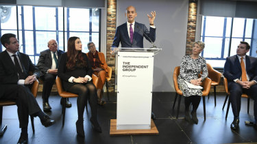 Labour MP Chuka Umunna (centre) speaks to the media during a press conference with a group of six other Labour MPs.