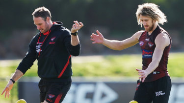 One-two step: Ben Rutten (left) with Essendon captain Dyson Heppell.