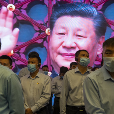 Visitors to the memorial built on the site of the first Communist Party congress in 1921, with Xi Jinping on a screen, June 2021.