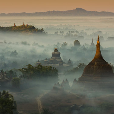 The temples and pagodas of misty Mrauk U, an archeological site in western Burma. Scenes of temples among misty hills are among the sights that had drawn tourists to Myanmar, largely uncharted since colonisation ended.