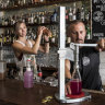 Tess Robens and Fabrizio Culici from The Rio Bar in Summer Hill bottle cocktails for home delivery to their customers to survive through the COVID-19 virus shutdown of bars in Australia.