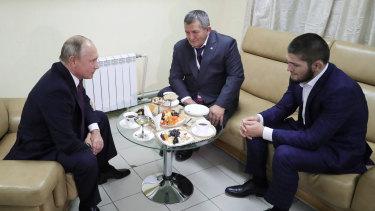 Comrades: Russian President Vladimir Putin (left) meets with Nurmagomedov (right) in Russia.