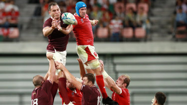 Giorgi Nemsadze of Georgia and Justin Tipuric of Wales compete for a line out ball.