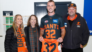 Kieren Briggs receives his GWS jersey before his club debut last month.