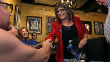Vermont Democratic gubernatorial candidate Christine Hallquist shakes hands with her supporters during her election night party in Burlington, Vermont.