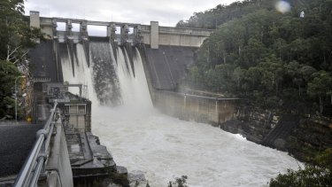 Water flows over the wall at Warragamba Dam.