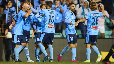 Sydney FC celebrate Rhyan Grant's goal in their win over the Phoenix on Sunday.