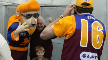 Lions' den: Fans pose for a picture with the Brisbane mascot.