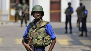 Sri Lankan navy soldiers keep guard outside St Anthony's Church in Colombo on Thursday after more suspicious items were found.