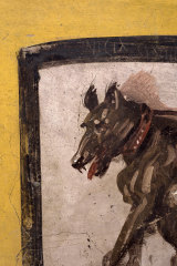 The painting of the dog was scrawled with vulgar graffiti.
