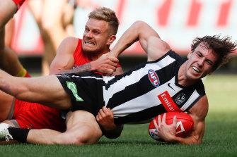 Callum Brown is tackled by Brandon Ellis.