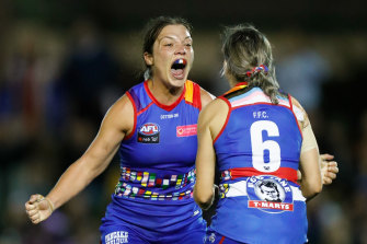 Ellie Blackburn and Kirsten McLeod celebrate as the final siren sounds on their win over the Blues.