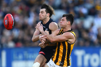 Lachie Plowman, left, and Jaeger O'Meara collide during round 10.