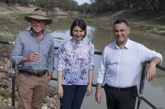 Premier Gladys Berejiklian flanked by Deputy Premier John Barilaro on her left and Adam Marshall, the Agriculture Minister, on her right.