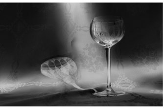 Glass shadow on embroidery: an image from In My Mother's House, Nocturnes