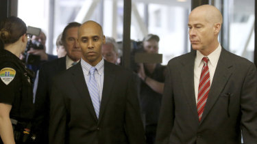 Former Minneapolis police officer Mohamed Noor walks through the skyway with his attorney Thomas Plunkett, right, on the way to court.