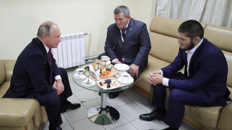 Comrades: Russian President Vladimir Putin (left) meets with Nurmagomedov (right) in Russia.