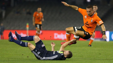 Eric Bautheac of Roar is tackled by Victory's Leigh Broxham.