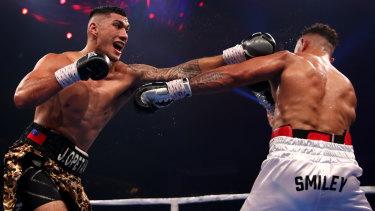 Jai Opetaia (left) is unbeaten in 18 fights.