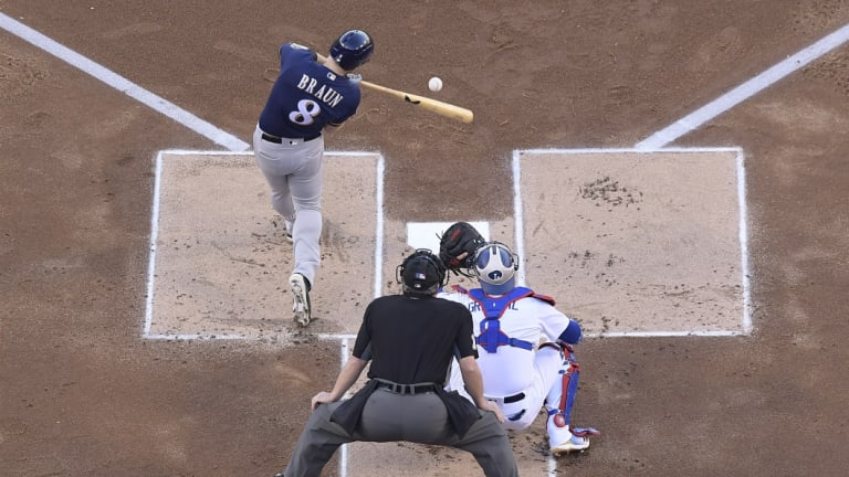 Ryan Braun bats in a run in the first inning against the Dodgers in game three.