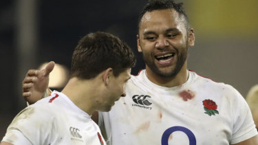 One for the scrapbook: England's Billy Vunipola celebrates with Ben Youngs after the win against Ireland.