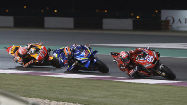 Italian Andrea Dovizioso leads the way during a tight race in the MotoGP season-opener in Qatar.