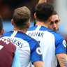 Aaron Mooy of Brighton and Hove Albion is dismissed by referee David Coote after receiving a second yellow card.